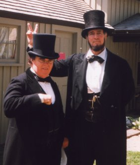 Max, as President Lincoln, giving Kevin Griffin, as Senator Douglas, rabbit ears